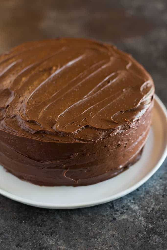 A two layer chocolate cake with chocolate frosting.
