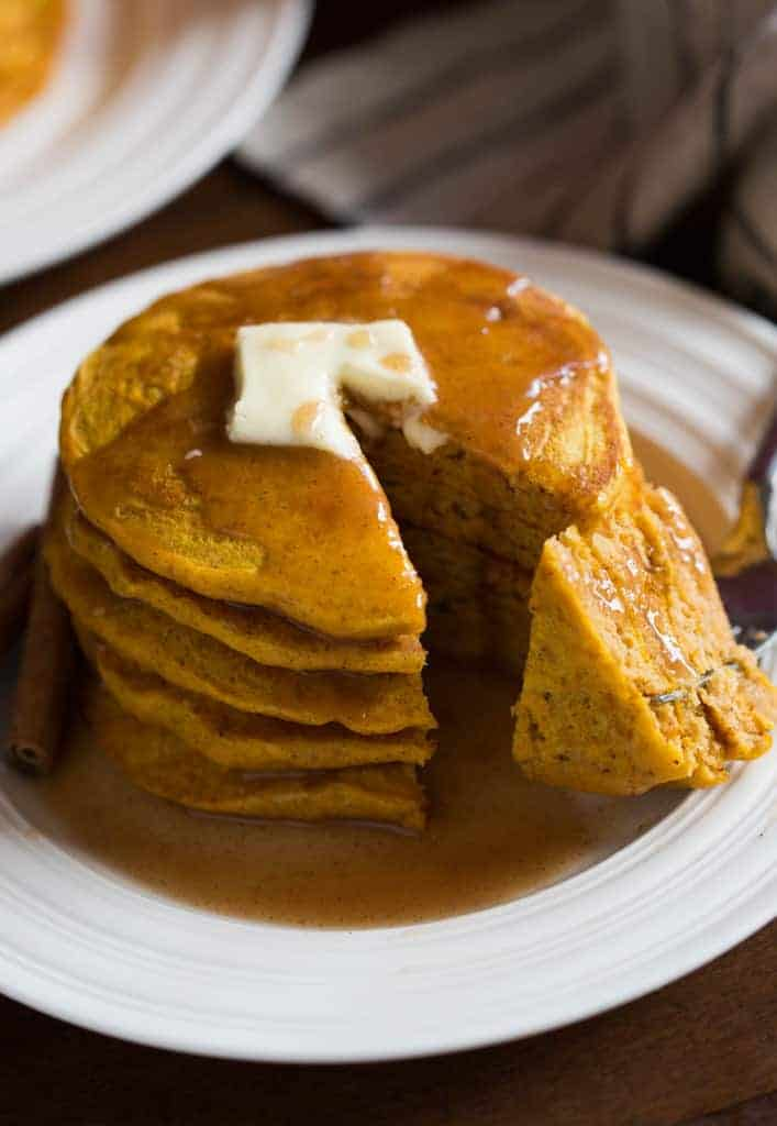 Pumpkin Pancakes with cinnamon syrup is my favorite Fall breakfast! Super light and fluffy homemade pumpkin pancakes with a delicious, creamy cinnamon syrup.
