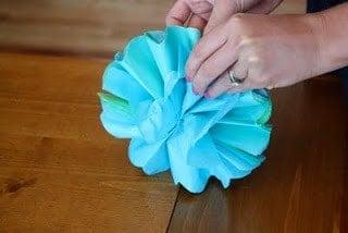 A tissue paper pom pom ball