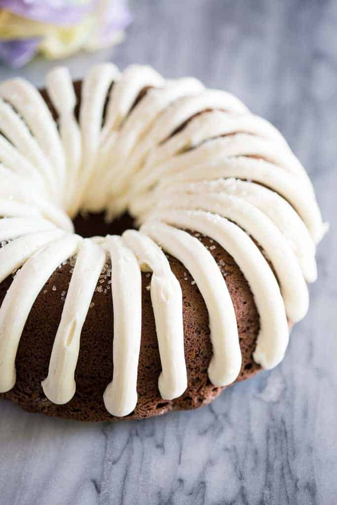 Nothing Bundt Cake copycat cat frosted with cream cheese frosting.