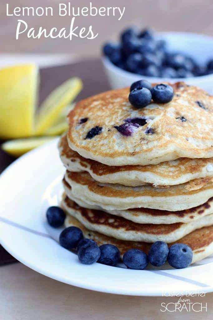 A stack of Lemon Blueberry Pancakes with fresh blueberries on top.