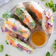 Fresh spring rolls on a plate with peanut dipping sauce,