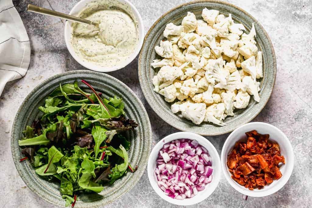 The ingredients needed to make Cauliflower Salad.