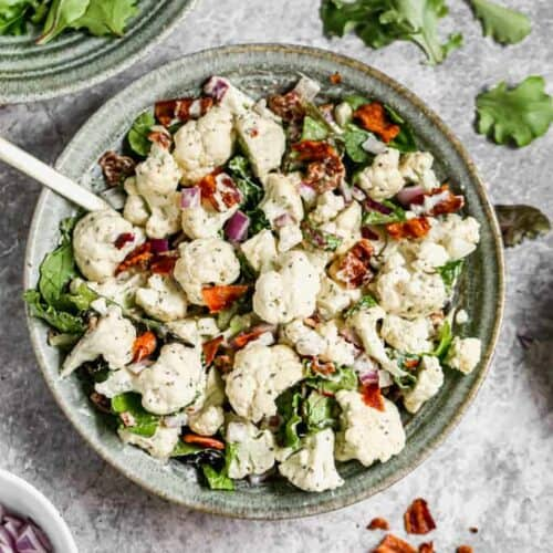 Cauliflower Salad made with raw cauliflower and cooked bacon,served in a bowl.