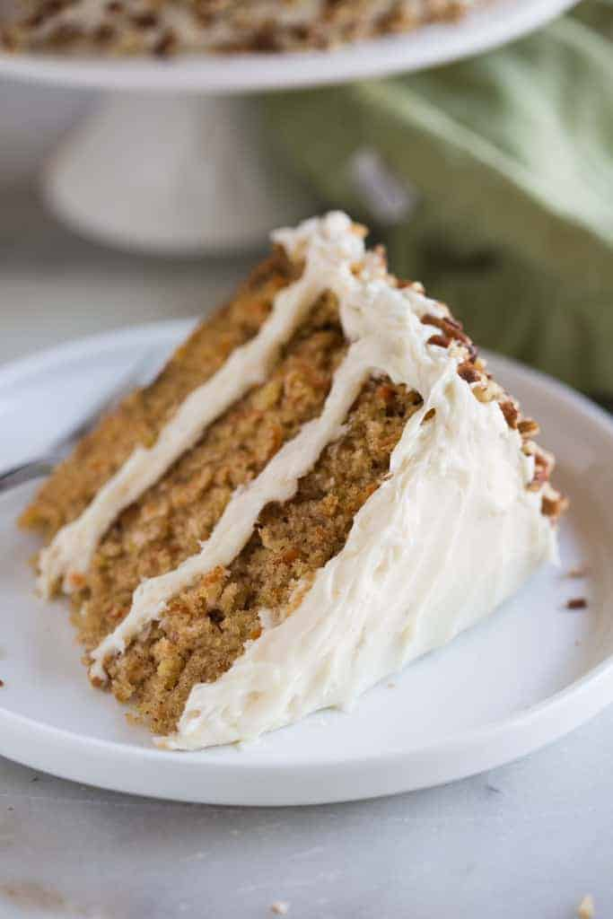 The absolute best carrot cake around, with all of the good stuff to make it extra flavorful and moist. This is the Ultimate Carrot Cake with cream cheese frosting