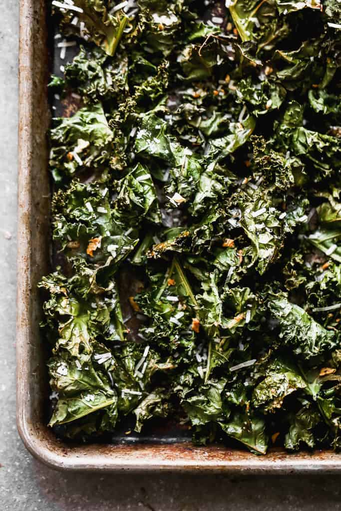 Baked kale chip on a sheet pan.