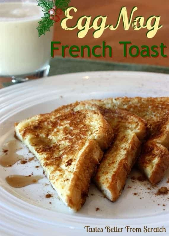 Three slices of egg nog french toast on a white plate.