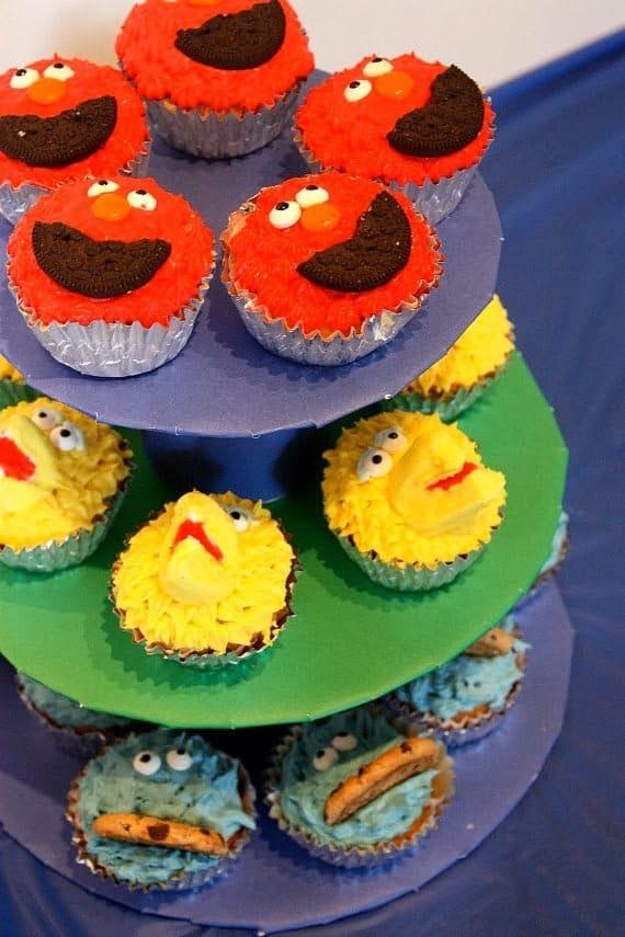 A platter of sesame street cupcakes.