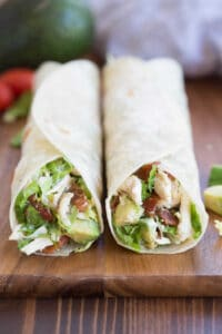 My whole family loves these Chicken Bacon Avocado Wraps. They are easy to make, with simple ingredients like shredded chicken, bacon, avocado and lettuce tossed together in a simple dressing. | tastesbetterfromscratch