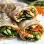 three veggie wraps stacked on one another.