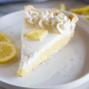A slice of the BEST Lemon Sour Cream Pie - tastesbetterfromscratch.com