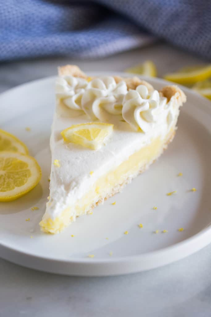 A slice of the BEST Lemon Sour Cream Pie - tastesbetterfromscratch.com