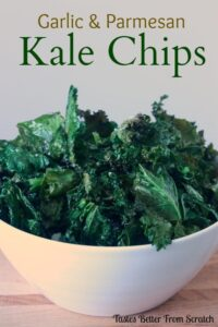 A bowl filled with kale chips that have been roasted with garlic and parmesan.