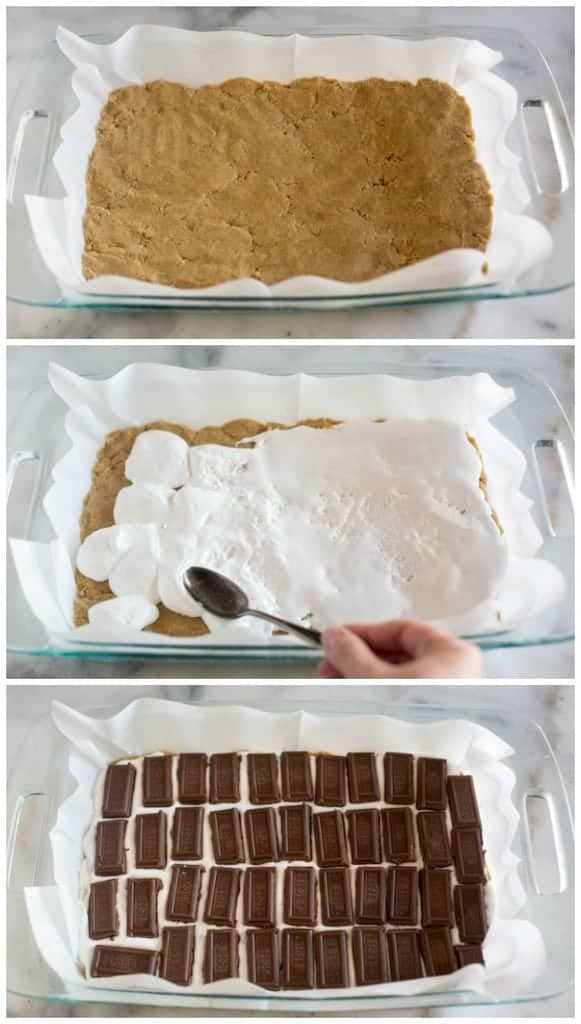 Process photos for making s'more cookie bars including a layer of graham cracker cookie dough in the bottom of a parchment lined 9x13 inch pan, topped with marshmallow creme and chocolate bars.