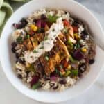 Honey-Lime Chipotle Chicken Fajitas bowls served with cilantro lime rice and black beans.