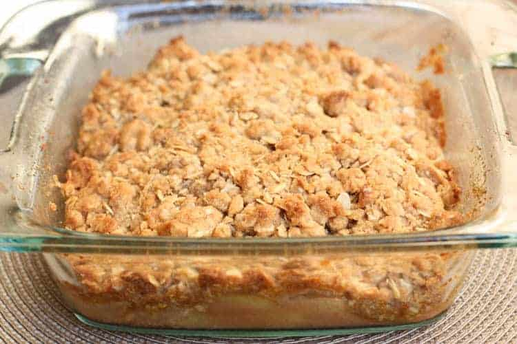 An 8x8'' glass baking dish of apple crisp.