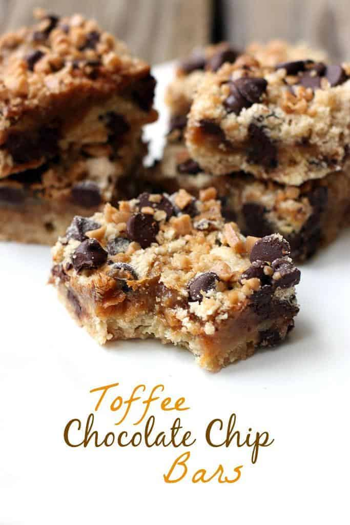Several Toffee Chocolate Chip Bars with a caramel filling and chewy crust, on a white plate
