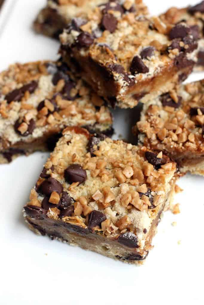 Several Toffee Chocolate Chip Bars on a white plate.