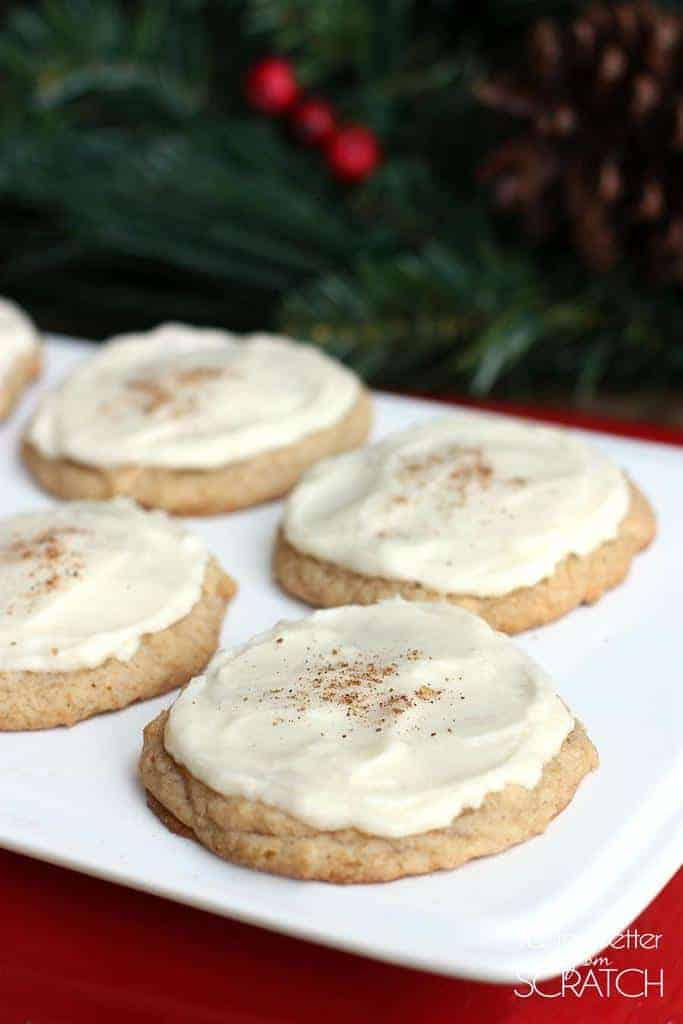 Chewy and soft cookies with eggnog frosting on a white plate