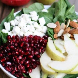 Pear and Pomegranate Salad with Feta Cheese, Nuts, and a Champagne Vinaigrette