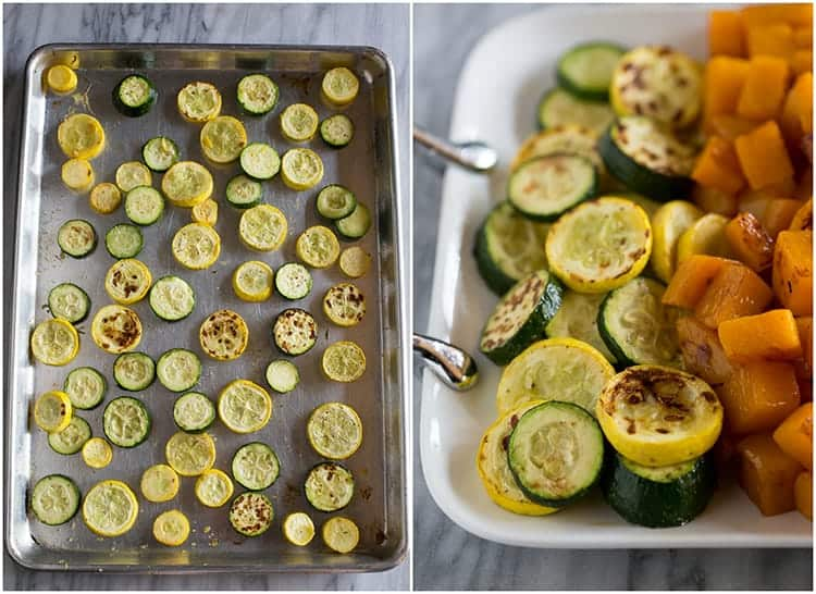Zucchini and summer squash roasted on a baking sheet and then served on a platter.