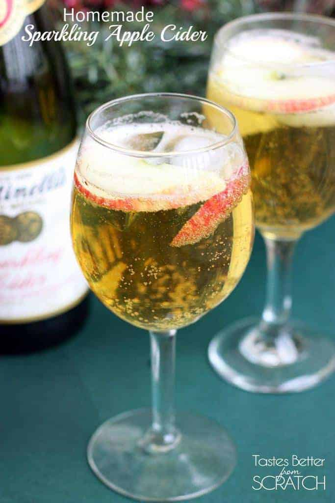 Two wine glasses filled with Homemade Sparkling Apple Cider (Martinelli's).