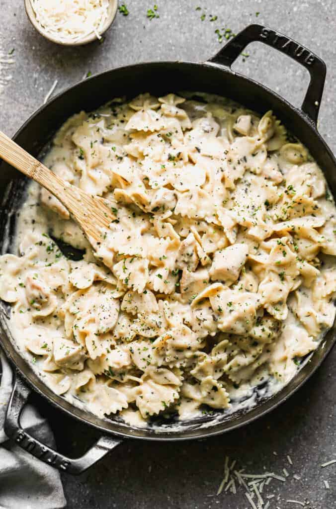 A large skillet with one pan healthy chicken alfredo.
