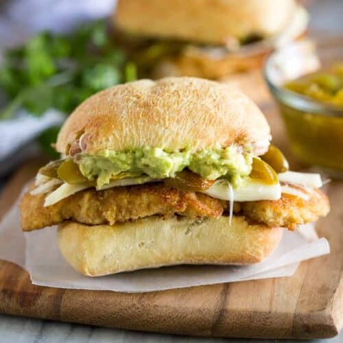 Mexican Torta sandwich with chicken , cheese, avocado and pickled jalapeno on a ciabatta roll.