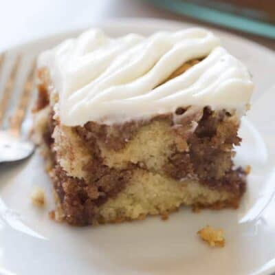 Light and tender cinnamon roll cake with cream cheese frosting is one of my favorite brunch recipes! All of the flavors I love from a cinnamon roll, in a delicious cake. | tastesbetterfromscratch.com