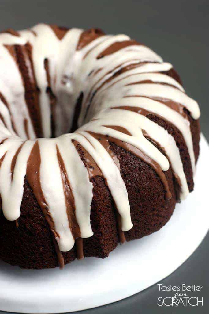 The right side of a Chocolate Macaroon Bundt Cake that is on a white cake platter.