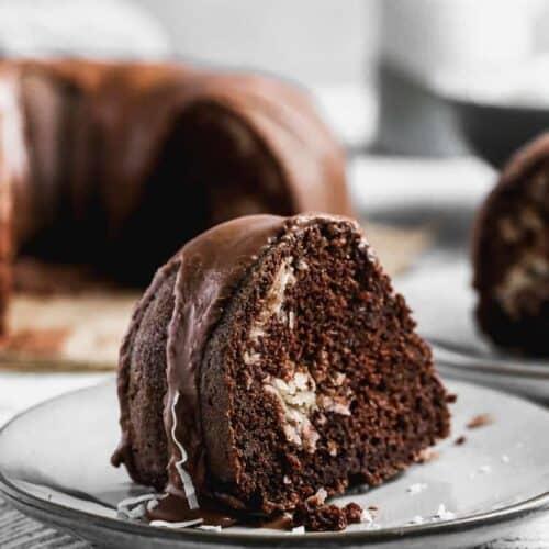 A slice of chocolate macaroon cake on a plate.
