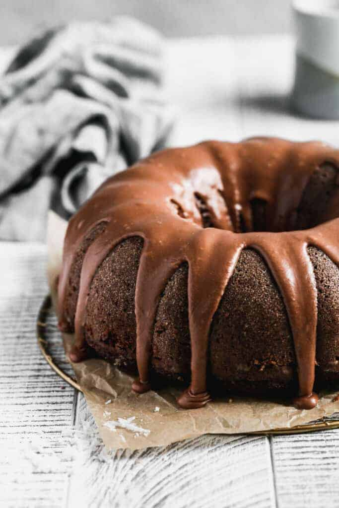A chocolate bundt cake with chocolate glaze on top.