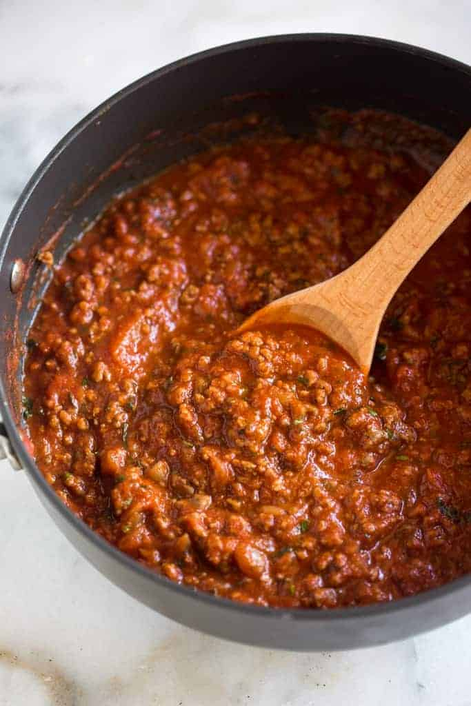Make pasta sauce with crushed tomatoes