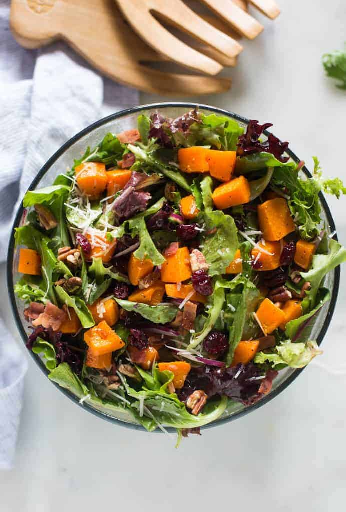 Roasted Butternut Squash Salad in a glass bowl. | tastesbetterfromscratch.com