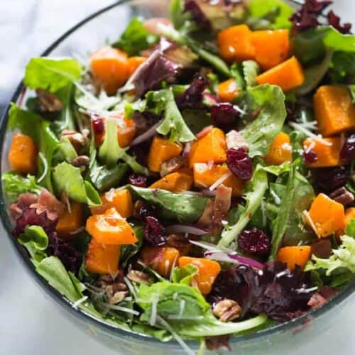 Roasted Butternut Squash Salad with pecans, bacon, onion, craisins, parmesan cheese and a simple balsamic vinaigrette.   tastesbetterfromscratch.com