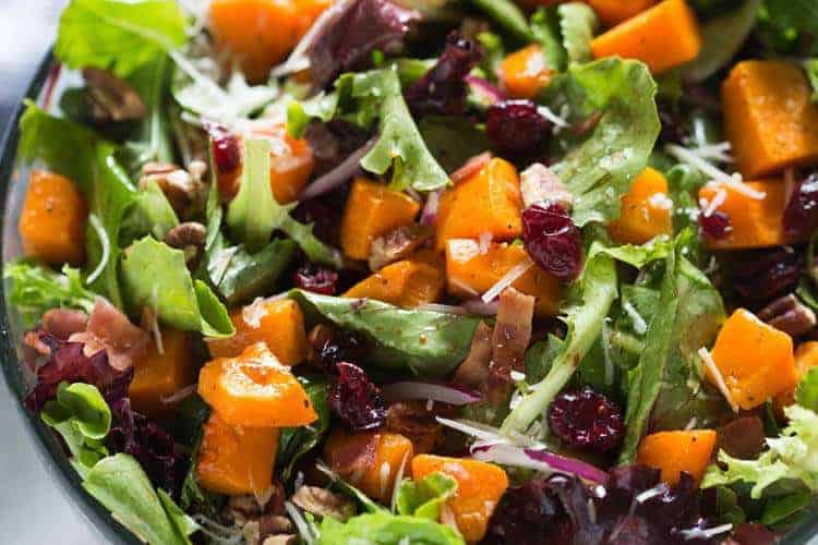 Roasted Butternut Squash Salad with pecans, bacon, onion, craisins, parmesan cheese and a simple balsamic vinaigrette. | tastesbetterfromscratch.com