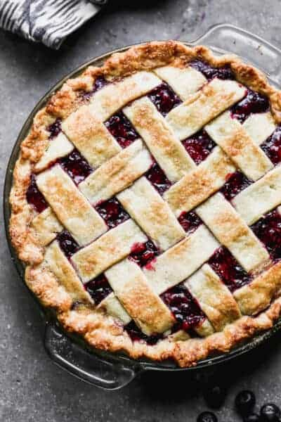 Overhead view of a berry pie with a lattice crust.