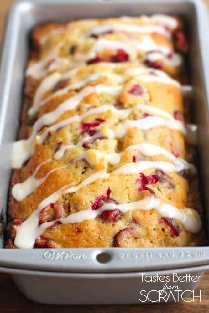 A bread pan faced vertically and filled with baked cranberry orange bread.