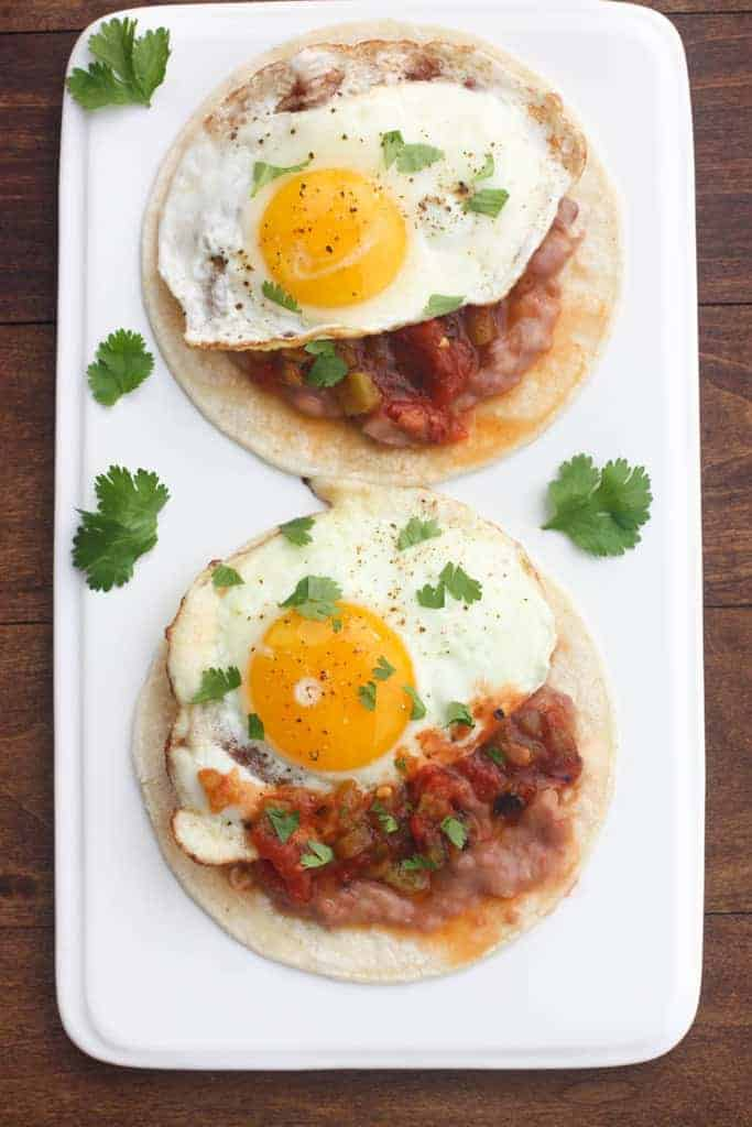 Huevos Rancheros -- a Mexican breakfast dish with corn tortillas, refried beans, salsa and a fried egg.