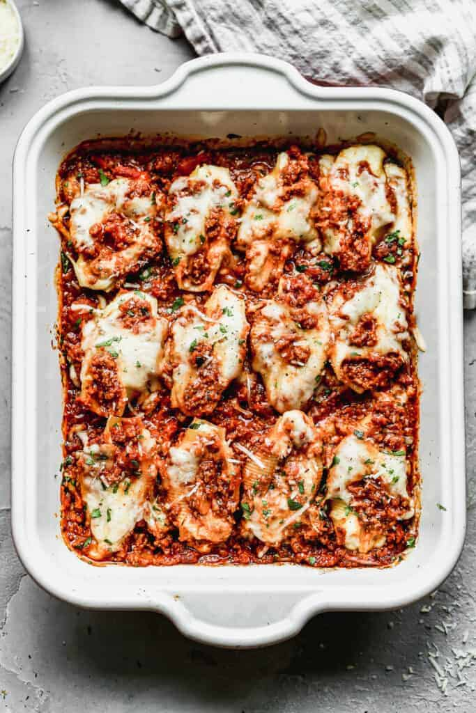 Lasagna Stuffed Shells baked in a white casserole dish.