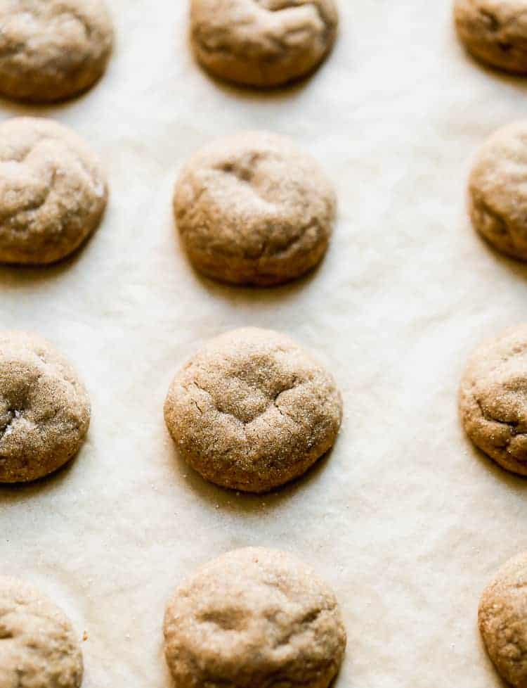 Close-up of molasses cookies on parchment paper.