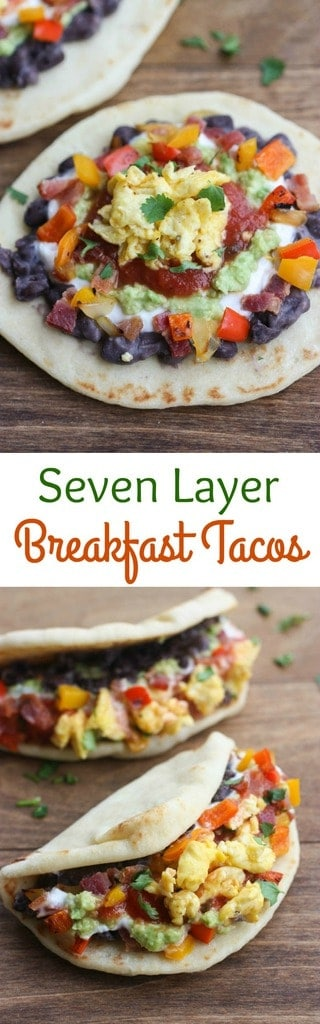 Seven Layer Breakfast Tacos with eggs, bacon, refried beans, avocado, salsa, and sour cream served in warm mini naan. | tastesbetterfromscratch.com