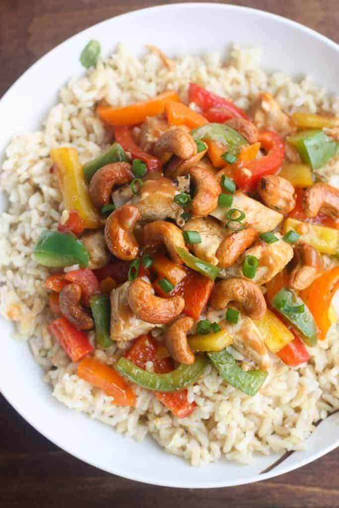 Skinny Asian Chicken Stir-Fry with Honey Roasted Cashews - an easy, healthy, flavorful meal packed with protein and veggies and served over brown rice. | Tastes Better From Scratch