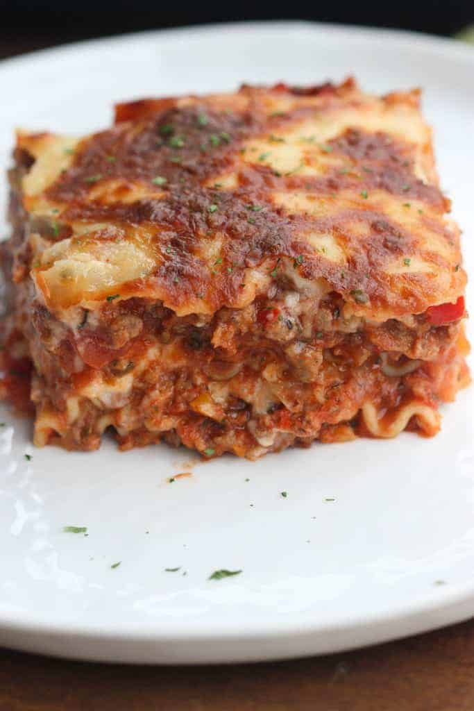 Amazing A Close Up Image Of A Serving Of Lasagna, On A White Plate, That