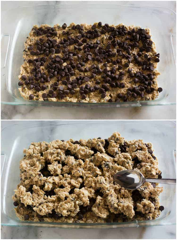 A clear glass 9x13 inch pan with cookie dough pressed into the bottom and chocolate chips sprinkled over the top, above a photo of the same pan with more cookie dough pieces placed over the chocolate chips and a spoon making it smooth.