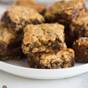 Oatmeal Chocolate chip cookies bars stacked on a plate, ready to eat.