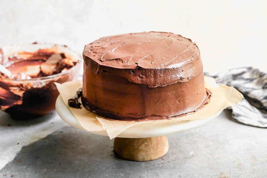A layered round chocolate cake with chocolate frosting.