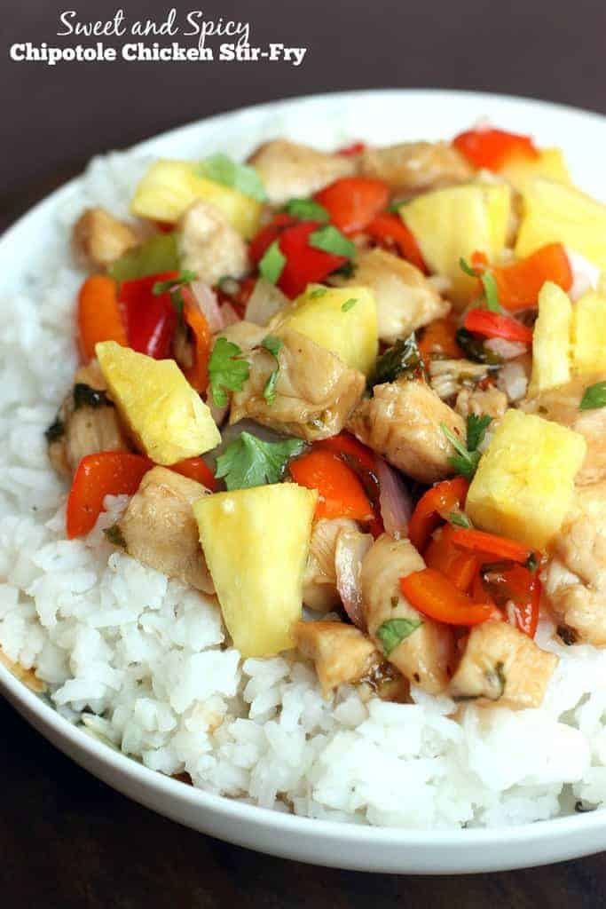 Stir-Fry chicken and vegetables in a chipotle sweet and spicy sauce. Served over rice with fresh pineapple! Would taste great in a lettuce wrap too!