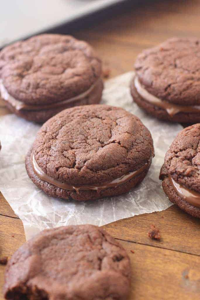 Chocolate Nutella Sandwich Cookies - The BEST chewy chocolate nutella cookies, sandwiched together with a spoonful of nutella in the center.