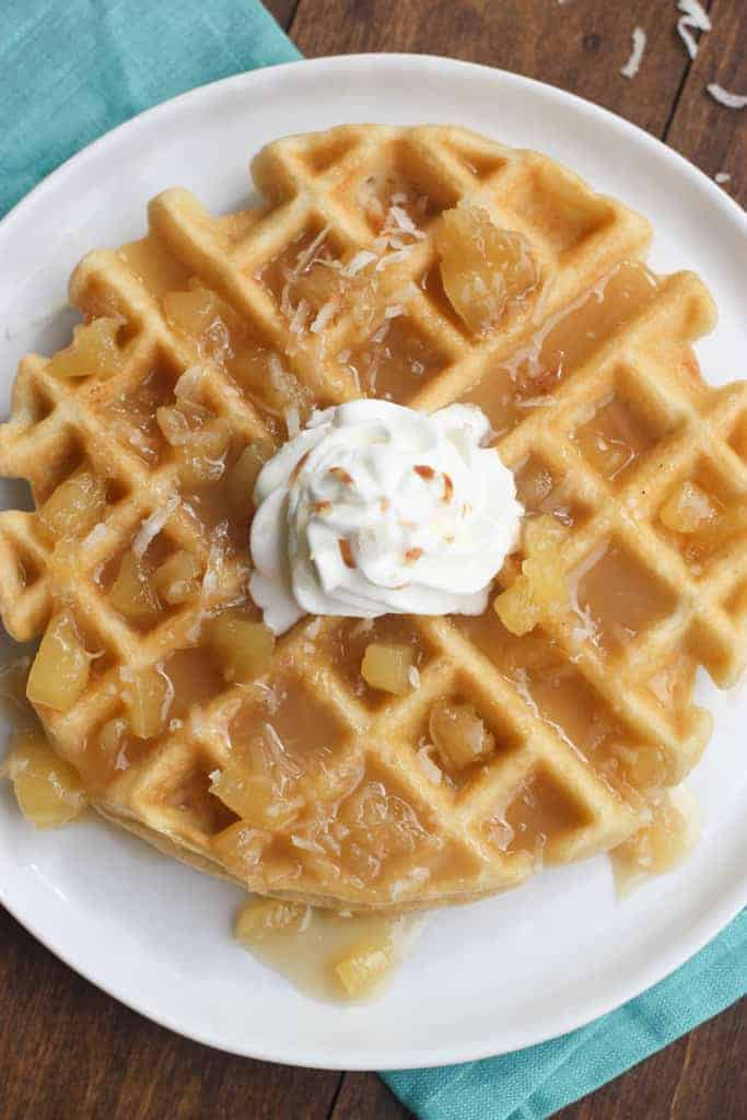 An overhead shot of a Coconut Cream Waffles with Pineapple Syrup